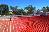 METALFIX being applied to a roof