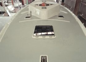 Newly built fibre glass yacht coated with light grey EASYTREAD