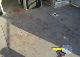 The condition of a boat's deck before the application of HARDPAVE