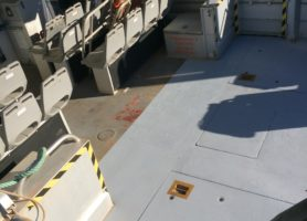 Contrast between the original deck of the boat and the deck painted with HARDPAVE