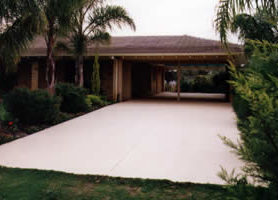 Light Grey HARDPAVE on double width concrete domestic driveway.