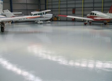 MAXICOAT shown on the floor of an aircraft hangar